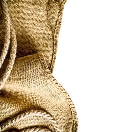 Burlap fabric on isolated white background photo