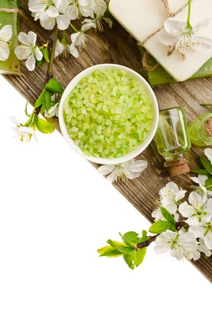 Spa with spring flowers on white background