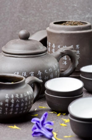 Tea ceremony on gray background with flowers photo