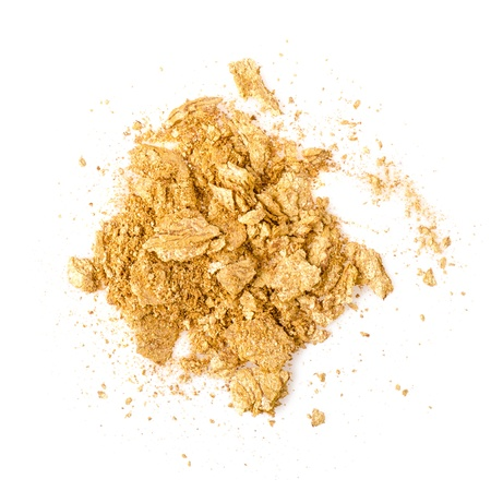gold facial: Crushed gold eyeshadow on white Stock Photo