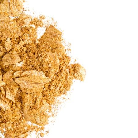 crush: Crushed gold eyeshadow on white Stock Photo