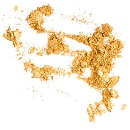 Crushed gold eyeshadow on white Stock Photo