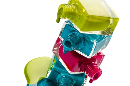 Bottles with spilled nail polish over white background   photo