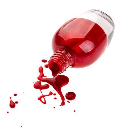 Red nail polish isolated on white background photo