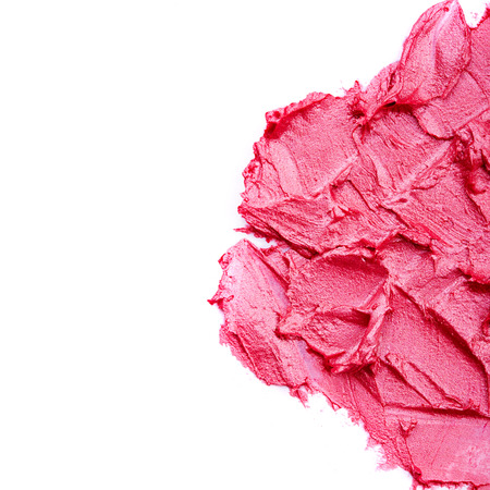 Smudged pink lipstick isolated on white background photo