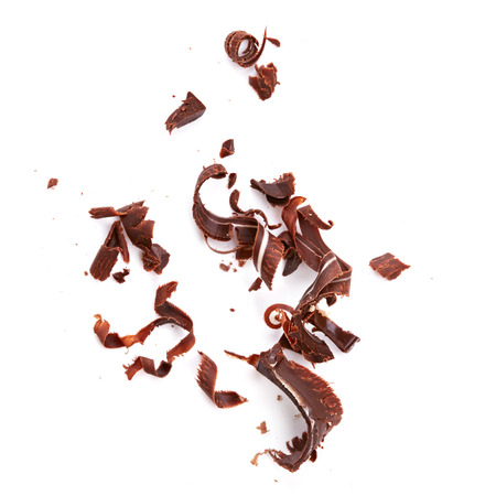 Chocolate shavings isolated on white background Imagens