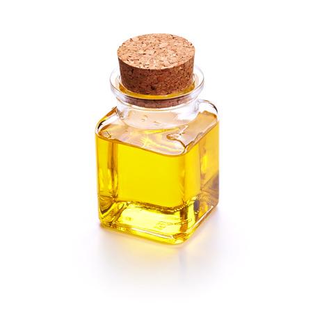 aceite de cocina: Botella con aceite aislado en el fondo blanco