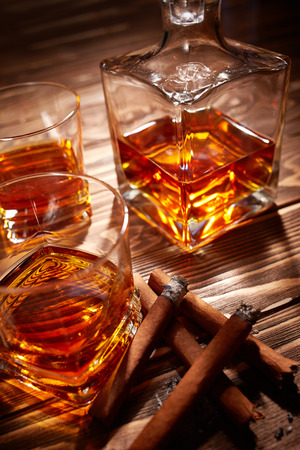 drunks: Vintage cognac with cigar over wooden background