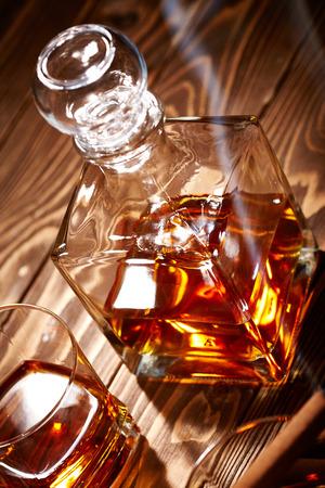 drunks: Vintage cognac with cigar over wooden background