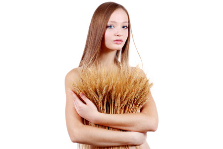 Beauty woman with ears of wheat isolated on white  photo