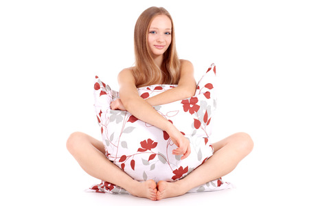 Thumbs up! Smiling girl with big pillow on isolated white background photo