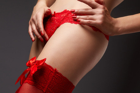 busty bra: Womans body in red lace underwear on grey background