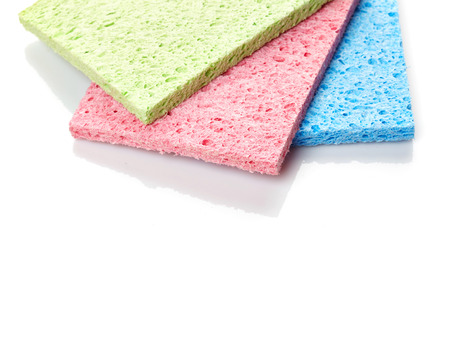 Household cleaning sponges isolated on white background photo
