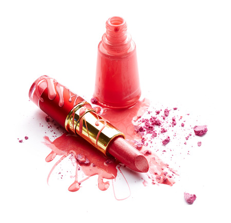 Pink nail polish, crushed eye shadow and lipstick isolated on white  photo