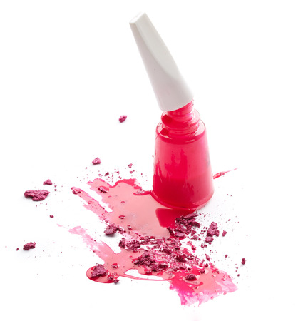 pink nail polish: Pink nail polish with crushed eye shadow isolated on white