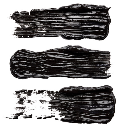 colourful paint: Strokes of black paint isolated on white background