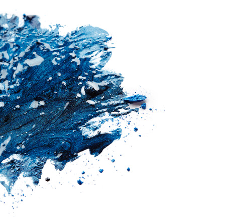 Blue nail polish and crushed eye shadow isolated on white background photo