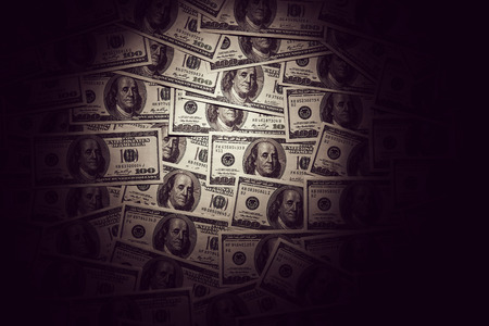 Dark vintage background of dollar banknotes photo