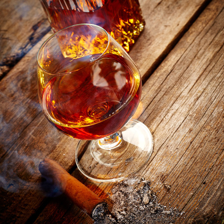 drunks: Vintage cognac still life on wooden background