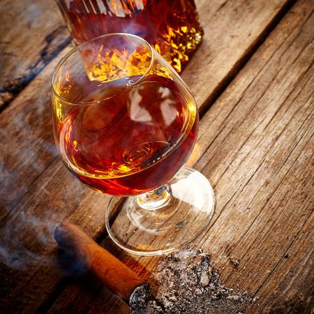 drunks: Vintage cognac still life on wooden background