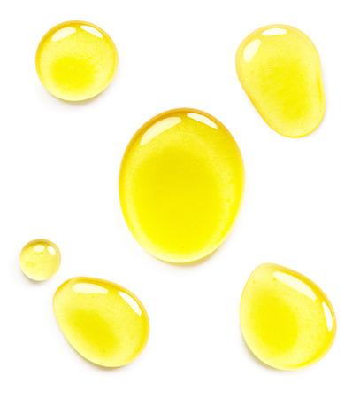 oil splash: Honey isolated on white