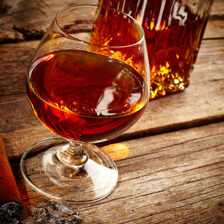 drunks: Vintage cognac still life on wooden  Stock Photo
