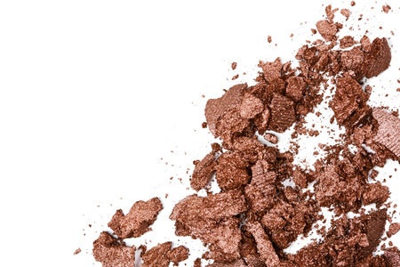 brown eye: Crushed brown eye shadow isolated on white background