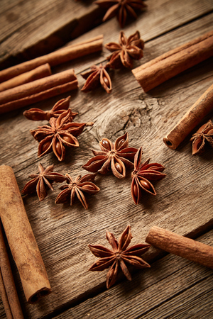 badian: Cinnamon and star anise on wooden background