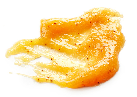 body scrub: Orange body scrub isolated on white background