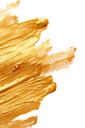 colourful paint: Strokes of golden paint isolated on white background Stock Photo