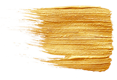Strokes of golden paint isolated on white background photo