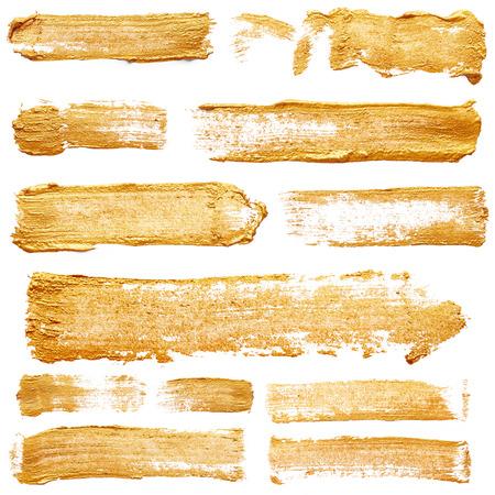 Strokes der goldenen Farbe auf weißem Hintergrund Standard-Bild - 37038298