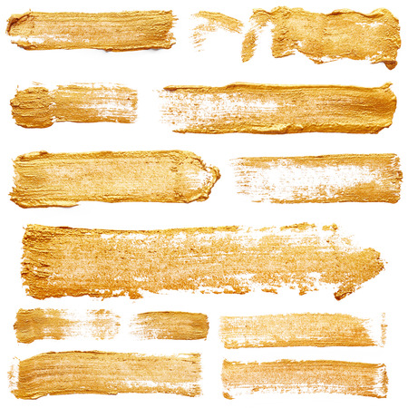 Strokes of golden paint isolated on white background Stock Photo