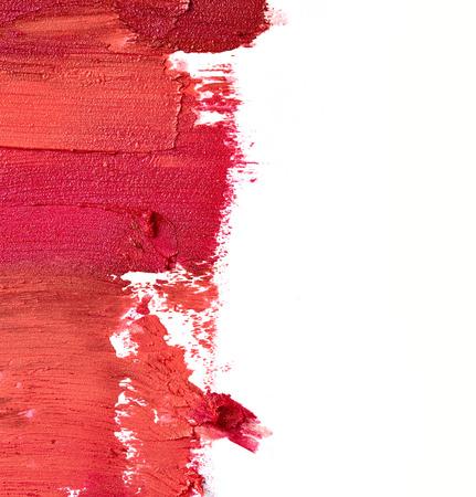 labios rojos: L�piz labial manchado aislado en fondo blanco