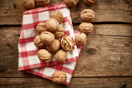 serviette: Walnuts on checkered serviette Stock Photo