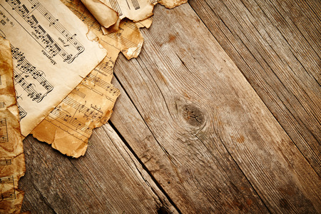 Vintage music sheet on wooden background