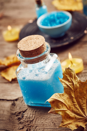 spa still life: Vintage blue spa still life with autumn leaves on wooden background Stock Photo