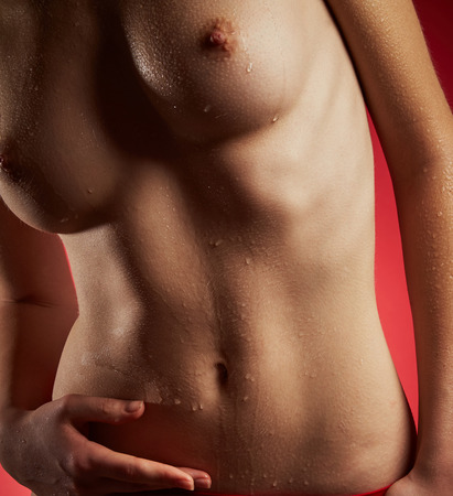 red breast: Young nude woman