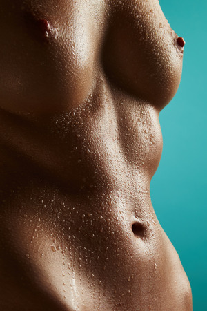 wet breast: Beautiful nude woman with drops of water