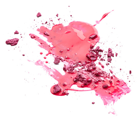 Pink nail polish with crushed eye shadow isolated on white background photo