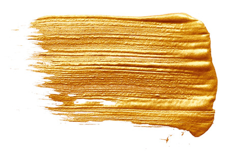 白い背景に分離された黄金の塗料のストローク 写真素材