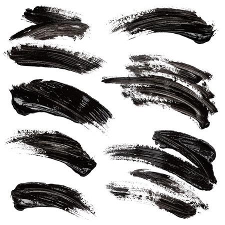 the brush: Movimientos de la pintura negro aislados sobre fondo blanco Foto de archivo