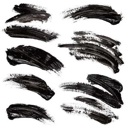 brush paint: Strokes of black paint isolated on white background