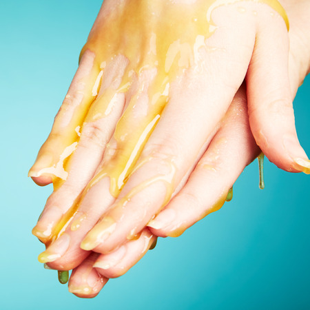 woman's hand: Womans hand in honey