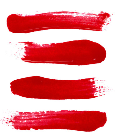 Strokes of red nail polish isolated on white background photo