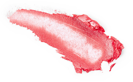 Smudged lipstick isolated on white background Фото со стока
