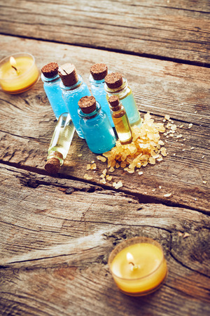 shower gel: Bottles with blue shower gel on wooden background