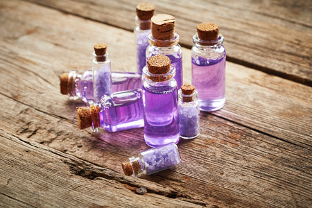 shower gel: Bottles with purple shower gel on wooden background