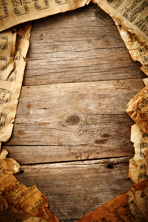 octaves: Vintage music sheet on wooden