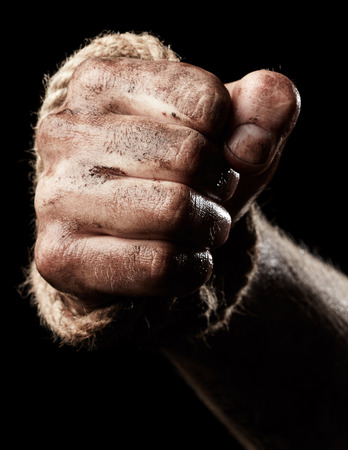 aggression: Male hand with rope on black background. Conception aggression